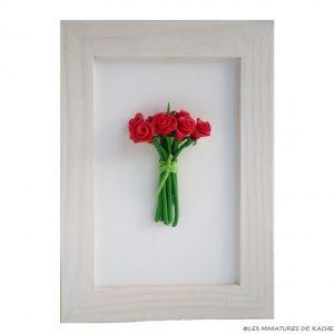 Cadre avec bouquet en pâte Fimo
